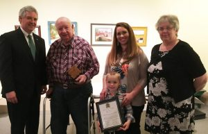 DNREC Secretary Shawn M. Garvin congratulates Kent County Agricultural Award honoree Alfred Moor Jr. of Smyrna, with his granddaughter-in-law Hallie Moor, great-grandson Everett Moor, and Gail Montgomery. Delaware Association of Conservation Districts also honors Legislator of the Year